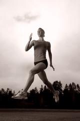 Serious Caucasian woman running