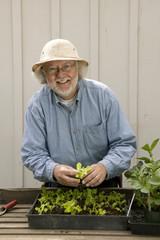 Caucasian man gardening