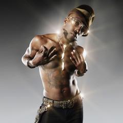 Trendy, tattooed African American man