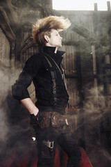 Trendy Caucasian man standing in warehouse
