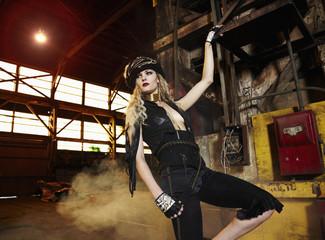 Trendy Caucasian woman in warehouse