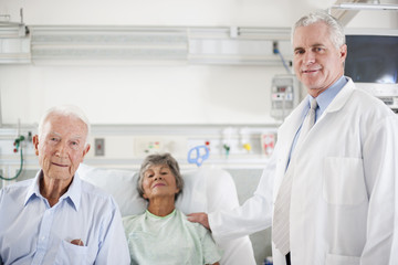 Doctor, patient and patient's husband in hospital room