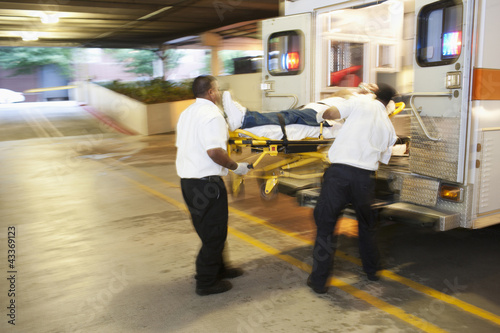 Medics transporting patient to hospital