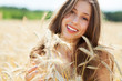 Beautiful woman in the wheat field