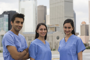 Doctors standing together in urban setting