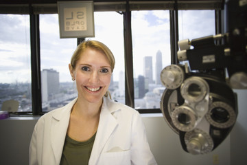 Caucasian eye doctor in office