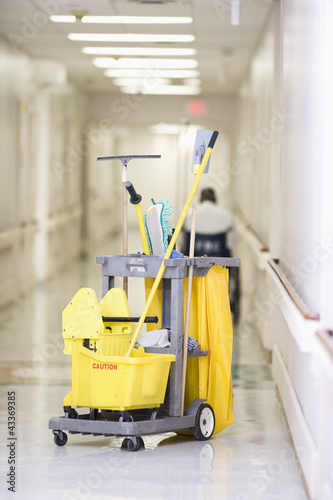Janitorial cleaning cart in hospital corridor