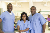 African American doctors standing together in clinic