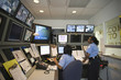 African American security guards working in control room