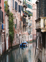 Boat moored in ornate canal