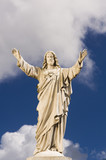 Statue of Jesus against sky