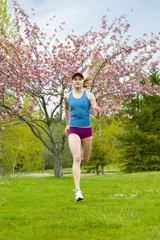 Mixed race woman running outdoors