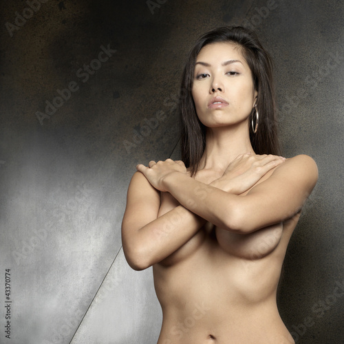 Nude Japanese woman covering her breasts