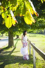 Glamorous Hispanic woman standing in park