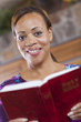 African American woman reading bible