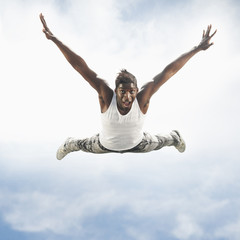 African American man jumping in mid-air