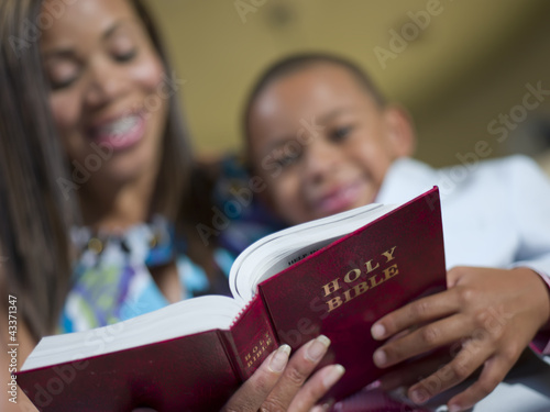 Mother and son reading bible