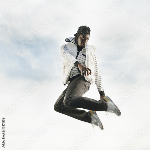 African American jumping in mid-air