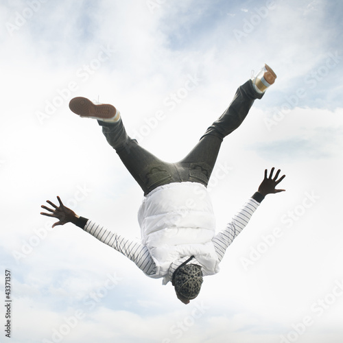 African American man upside-down in the air