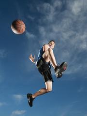 Caucasian man playing basketball