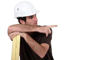 laborer leaning on planks