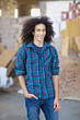 Smiling mixed race teenager with hands in pockets