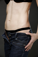 Young fit woman in jeans
