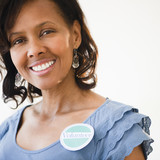Black woman wearing volunteer badge