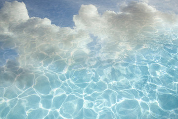 Clouds reflected in swimming pool water