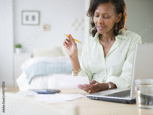 Black woman paying bills
