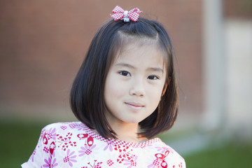 Smiling girl with bow in hair