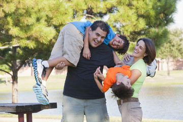 Hispanic family playing in park