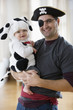 Mixed race father and baby boy in Halloween costumes