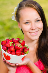 Girl and strawberries