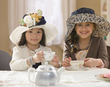 Girls dressed up having tea party