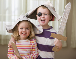 Caucasian brother and sister dressed as a pirates