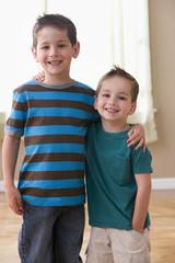 Caucasian brothers hugging