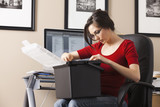 Caucasian woman working at desk in home office