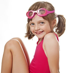 portrait of little girl with swim glasses