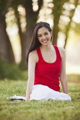 Caucasian woman sitting in grass