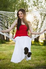 Caucasian woman sitting in hammock