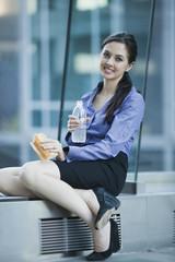 Caucasian businesswoman eating lunch