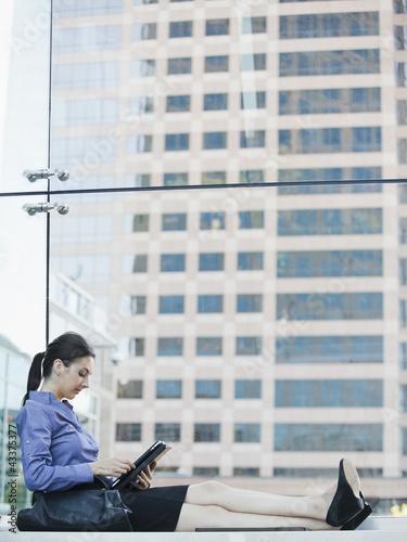 Caucasian businesswoman using digital tablet