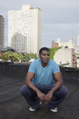 African American man standing on rooftop