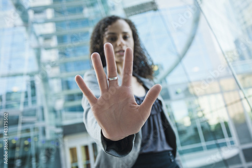 Caucasian businesswoman holding out hand