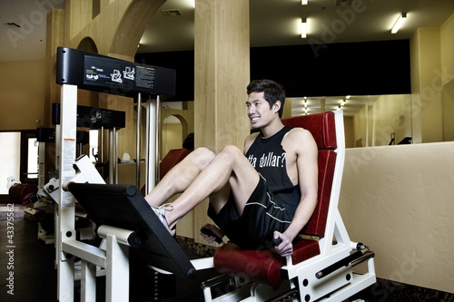Asian man exercising in health club