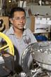 Hispanic man working on assembly line