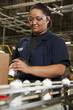 Hispanic woman working on assembly line