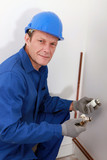 Plumber fixing heating system