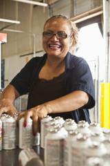 Hispanic woman working on assembly line
